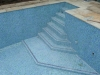 Pool is tiled and surround paved