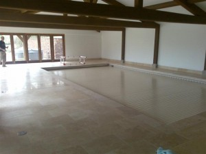 Indoor pool with slatted cover