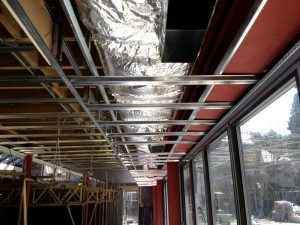 Pool hall ductwork concealed in the ceiling