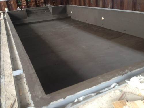 Swimming pool after first application of waterproof tanking
