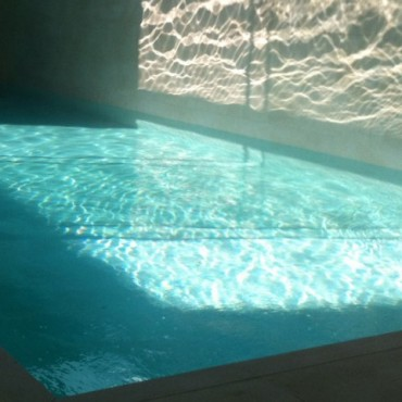 Pool with feature light wall