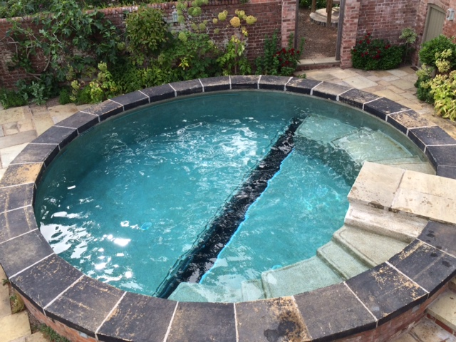 Hidden slatted cover for bespoke spa by brookforge pools for Bespoke swimming pools