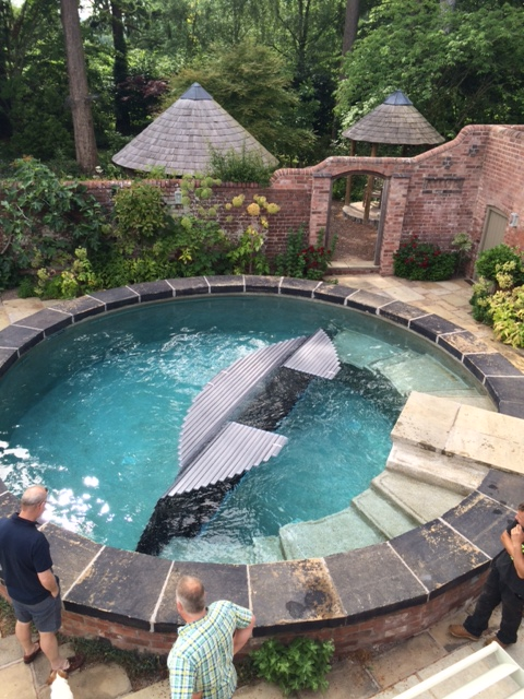 hidden slatted cover for bespoke spa by brookforge pools