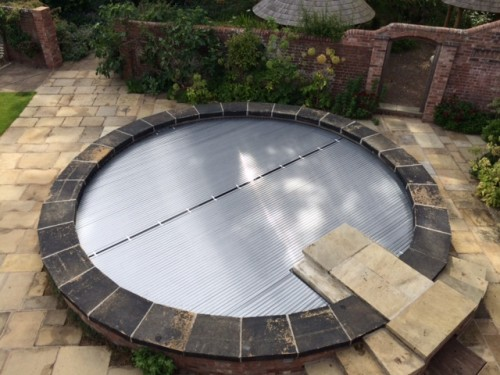 Automatic Slatted Cover On Round Spa