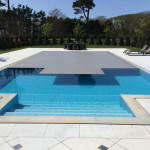 Swimming pool thermal slatted cover opening