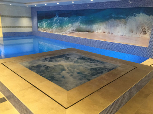 Slotted overflow spa in basement