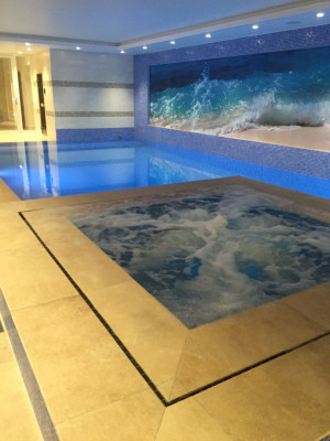 Hidden overflow pool and spa with massage jets