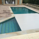 Swimming pool slatted cover opening