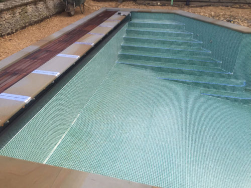 Refurbished swimming pool steps and cover pit