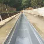 Finished overflow gutter