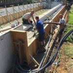 pumping concrete into overflow wall