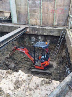 Digging a basement pool hall