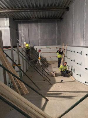 Pool wall bracing begins
