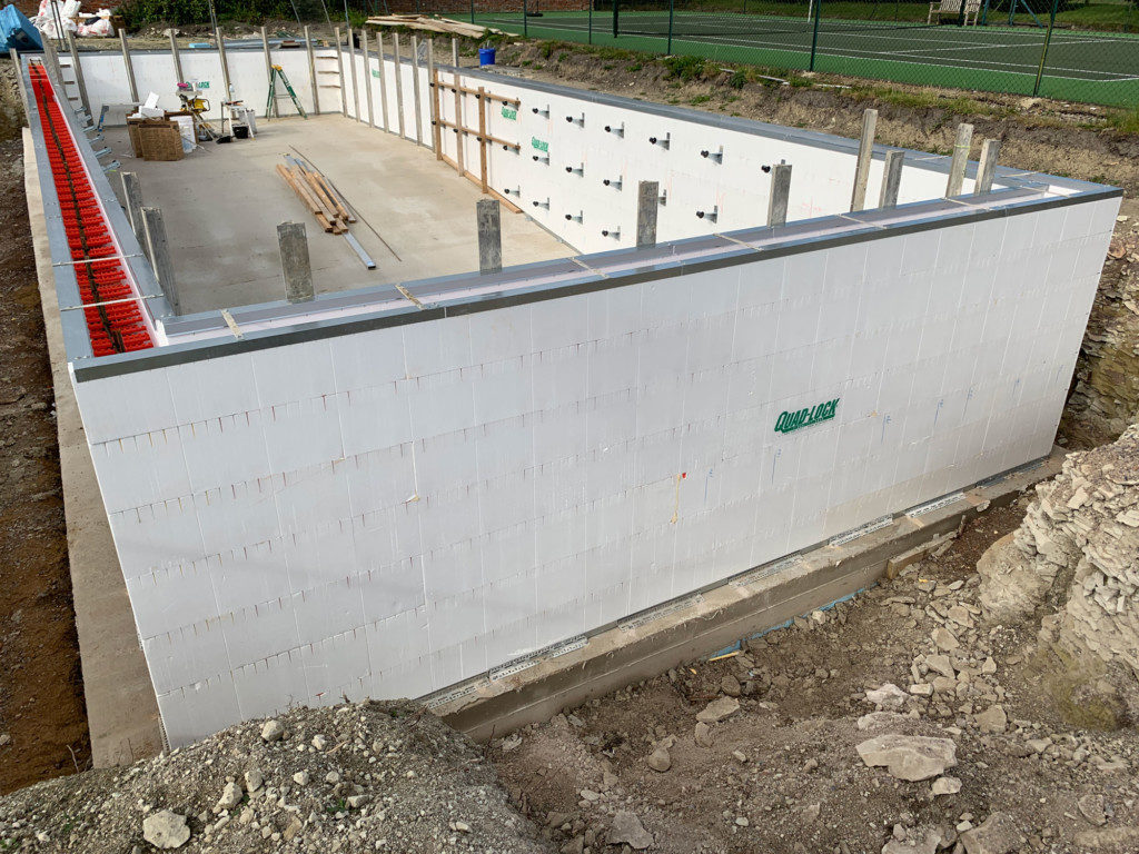 ICF pool construction with strong backs