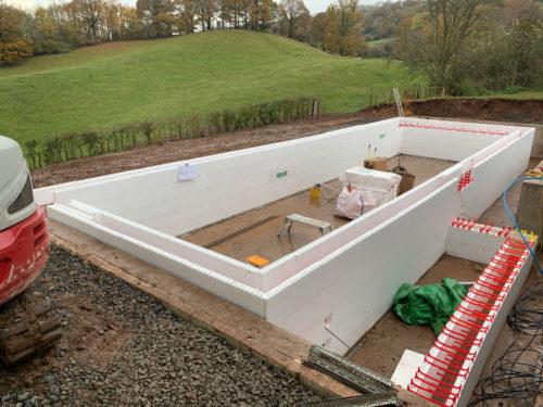 Quadlock ICF pool shell construction and balance tank