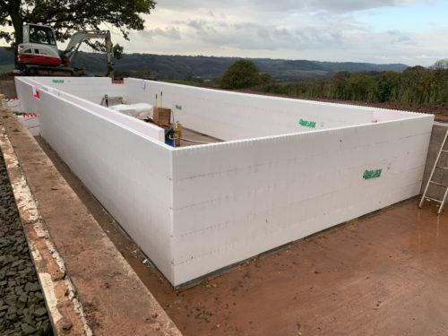 Quadlock pool shell construction