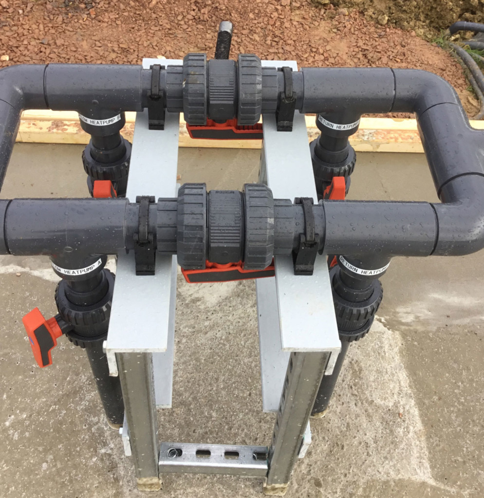 Pool heat pump manifold cast on concrete